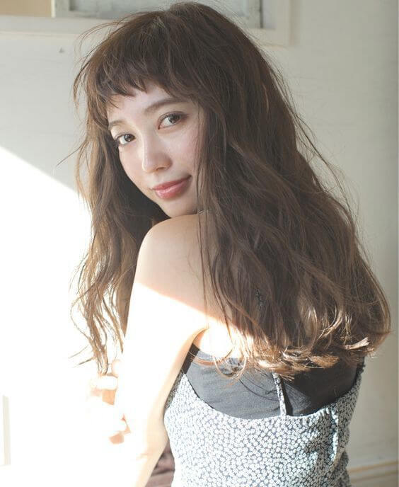 Kiểu tóc xoăn đẹp mái dài 1